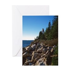 Lighthouse on shore Greeting Card