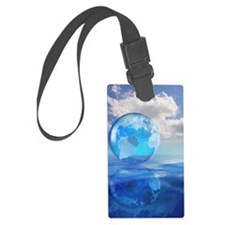 Globe floating over water in clo Luggage Tag