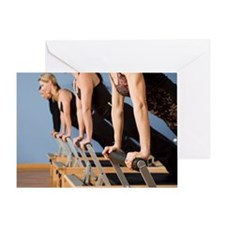 Women exercising in pilates class Greeting Card