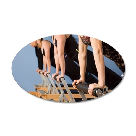 Women exercising in pilates  35x21 Oval Wall Decal