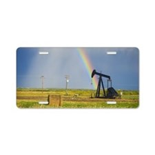 Storm clouds and rainbow ov Aluminum License Plate