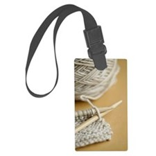 Knitting needles in position to  Luggage Tag