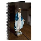 Statuette of the Virgin Mary Journal