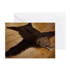 A bear skin rug on wooden floorboard Greeting Card