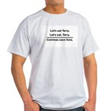 Lets eat, Terry. Commas save lives. T-Shirt