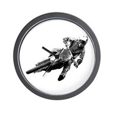 Grooving it on a dirt bike Wall Clock