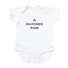 A Matched Pair Infant Bodysuit