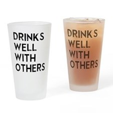 DRINKS WELL WITH OTHERS Drinking Glass