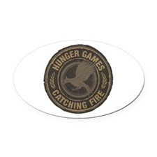 Catching Fire MockingJay Logo Oval Car Magnet